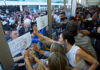 Hundreds of Bernie Sanders supporters and delegates held a silent protest inside and outside the Democratic National Convention media tent on Tuesday following the nomination of Hillary Clinton. (Stan Chambers Jr./WINK News)