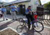 Bonita Springs resident Lynn Earl Brown takes a first ride on his new bike Thursday after city code enforcement officers Danielle Helmick, Lillian Villanueva, and others came together to purchase it for Brown. Brown was also presented with a photo album, composed of all his old family photos thought lost when his house was condemned and demolished by the city. Michel Fortier/Staff