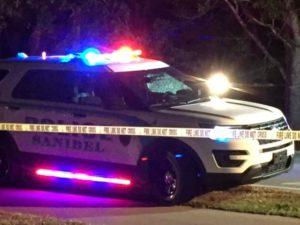 Broken glass can be seen in the windshield of the police vehicle where a Sanibel officer was shot during a traffic stop Sunday. ANN PEAY/WINK News