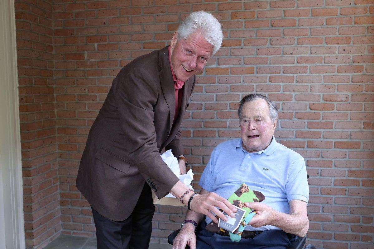 Bill Clinton meets George H. W. Bush, gifts socks