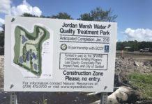 Jordan Marsh Water Quality Treatment Park sign. Photo via Taylor Bisacky.