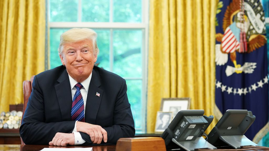 President Donald Trump in the oval office. Photo via CBS News.