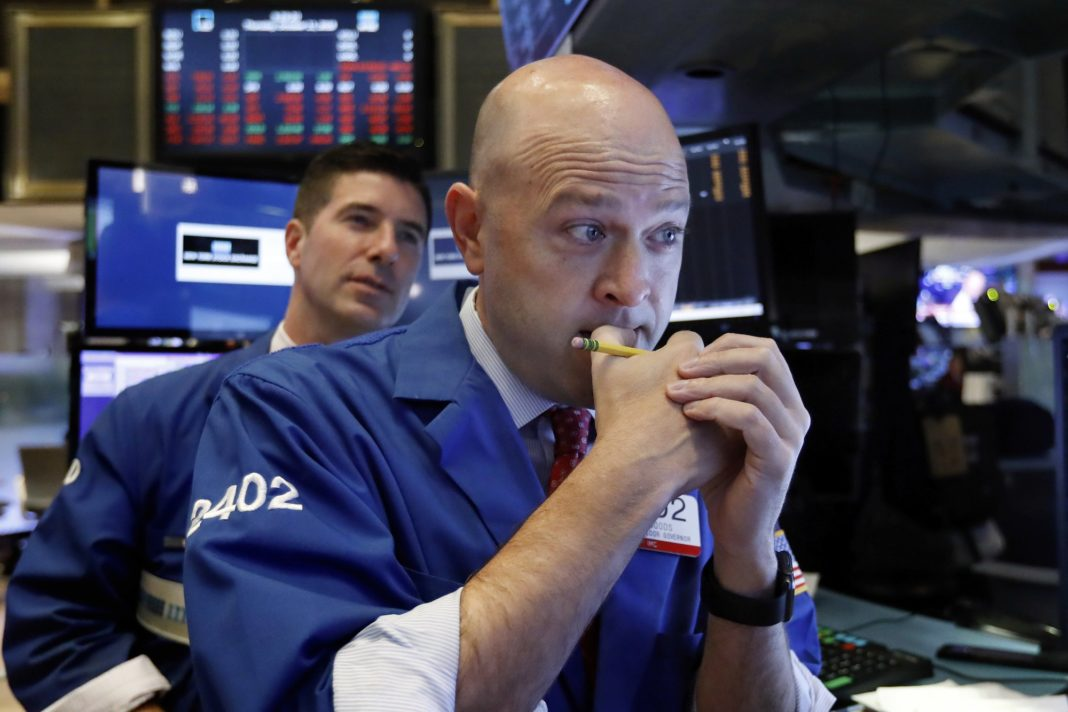 Specialists Jay Woods, right, and Thomas McArdle work on the floor of the New York Stock Exchange, Thursday, Oct. 11, 2018. Photo via AP/Richard Drew.