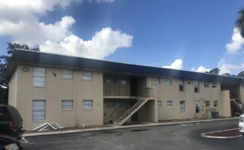 Jones Walker Apartments, renovated with a new paint job and roof shingles. Photo via WINK News.