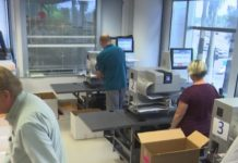 Lee County employees contributing to the Florida election recount on Tuesday. Photo via WINK News..