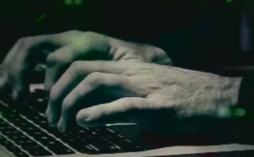 Person typing on the computer.