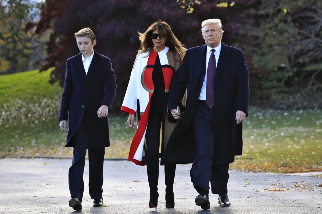 President Donald Trump with first lady Melania Trump and their son Barron Trump leave the White House Oval Office to travel to Mar-a-Lago in Florida. (AP photo)