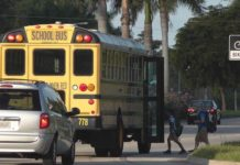 School bus stops to pickup children. Photo via Collier County Sheriff's Office.