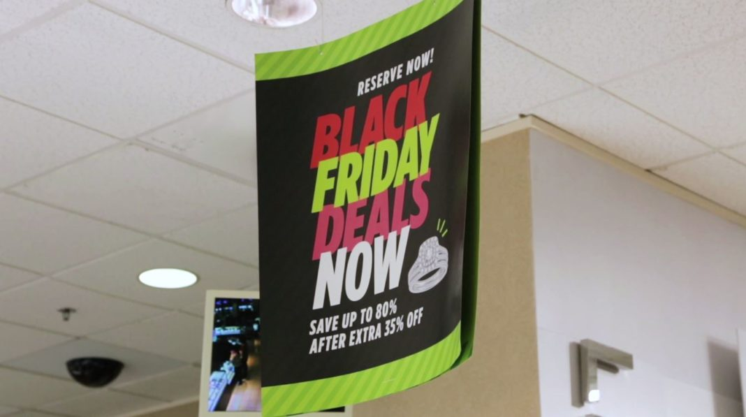 Sign advertising upcoming Black Friday sales. Photo via WINK News.