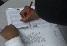 Student taking a standardized test. Photo via CBS.
