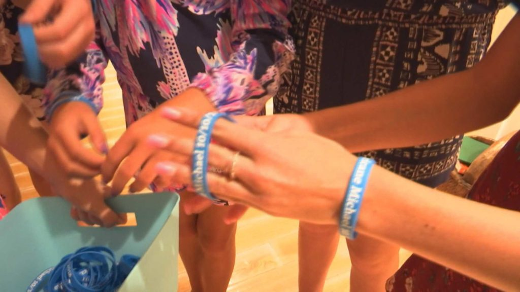 The girls sell these bracelets to raise money for Hurricane Michael victims. Photo via WINK News.