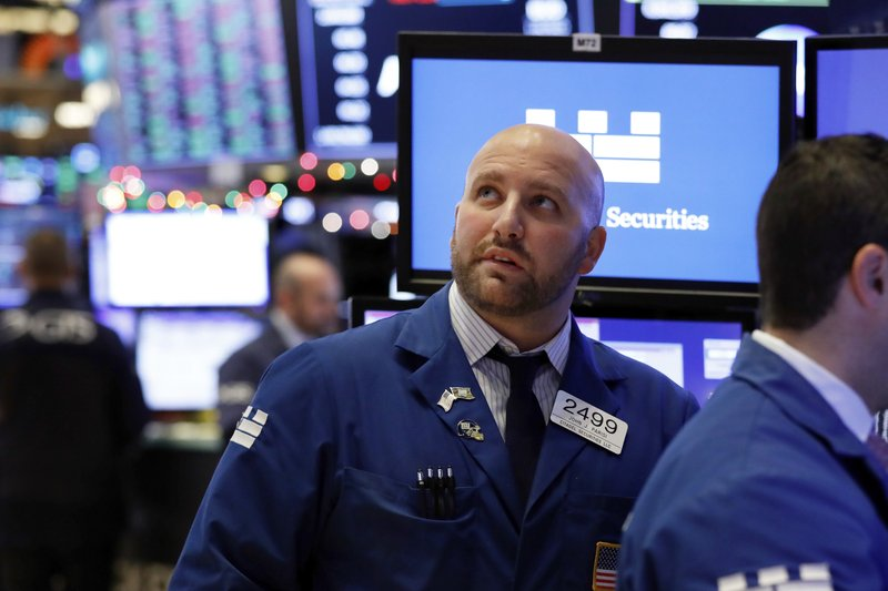 FILE: Specialist John Parisi watches the numbers near the close of trading on the floor of the New York Stock Exchange, Thursday, Dec. 27, 2018. U.S. stocks staged a furious late-afternoon rally Thursday, closing with gains after erasing a 600-point drop in the Dow Jones Industrial Average. (AP Photo/Richard Drew/FILE)