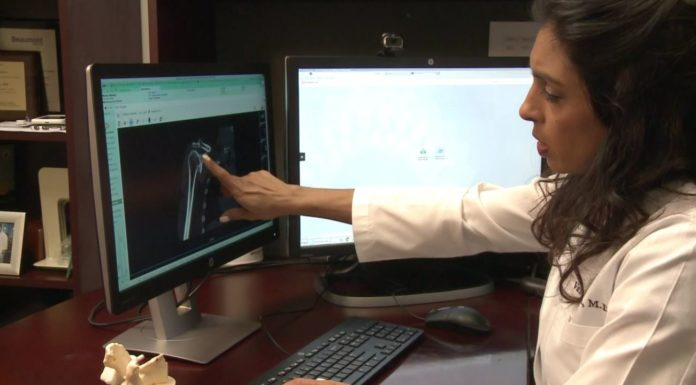 An orthopedic surgeon analyzes information in her office at the Cleveland Clinic Florida. Photo via WINK News.