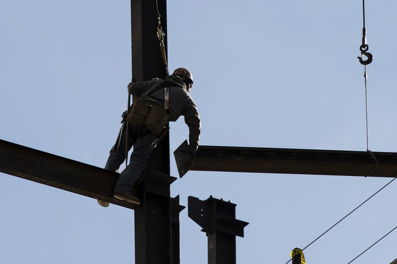 In this Nov. 29, 2018, file photo an Ironworker helps to construct a building in Philadelphia. Photo via AP.