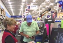 Man pays for items at a store in Collier County. Photo via WINK News.