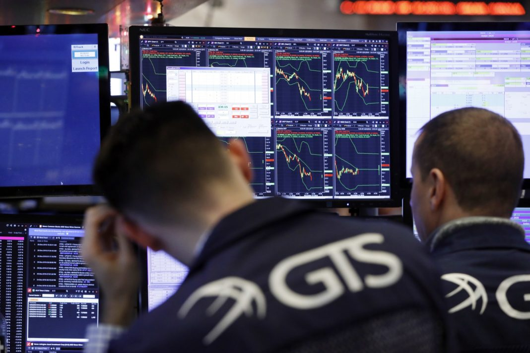 Specialists work at a post on the floor of the New York Stock Exchange, Wednesday, Dec. 26, 2018. Stocks are opening strongly higher on Wall Street Wednesday, with real estate, raw materials and energy stocks leading a broad rebound from Monday's Steep losses. Photo via AP/Richard Drew.