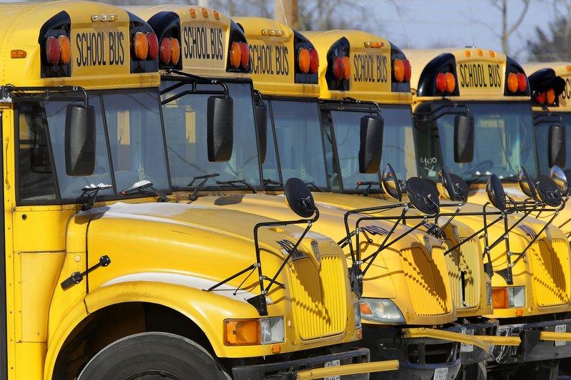 Parked school buses. Photo via AP/Seth Perlman.