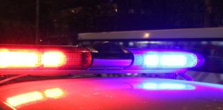 Police lights by night. Photo via CBS.