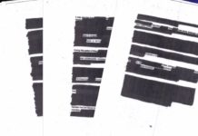 Portions of the heavily redacted Freeh Group Report. Photo via WINK News.