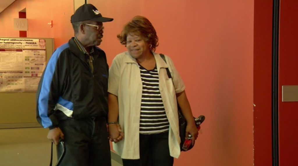 Ralph Stuart and his wife, Austine, hold hands together after a medical appointment. Photo via WINK News.