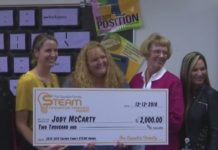 STEM teacher Jody McCarty receives a check with $2,000 in grant money on Wednesday, Dec. 12. Photo via WINK News.