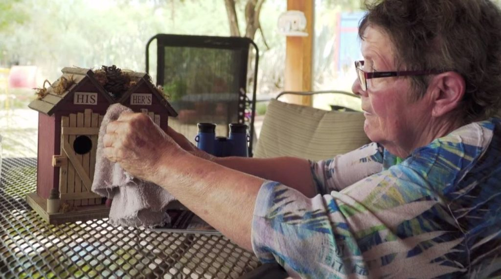 Sharon Kha enjoys interacting with birds. Butdyskinesia has become an impediment to her hobby. Photo via WINK News.