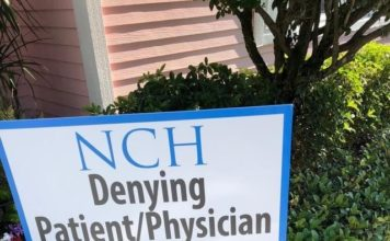 Signs claim NCH denies patients the right to choose their own physician. Photo via WINK News.