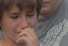 EJ Sabino, 11-years-old, seen sad over his family's lost. Photo via WINK News.