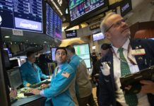 Stock markets around the world spiked higher Tuesday after Wall Street rebounded amid hopes the U.S. and China are back negotiating over their trade dispute. (AP Photo/Mark Lennihan).