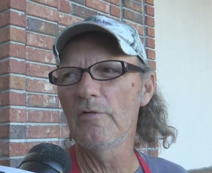 Terry Buck outside a Naples store while he volunteers for the Salvation Army. Photo via WINK News.