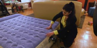 Woman sets up an air mattress. Photo via WINK News.