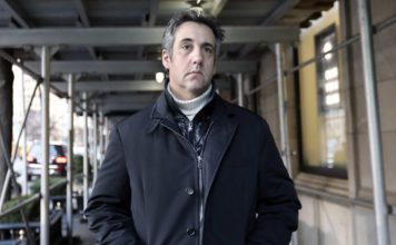 Michael Cohen, former lawyer to President Donald Trump, leaves his apartment building on New York's Park Avenue, Friday, Dec. 7, 2018. (AP Photo/Richard Drew)