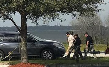 Suspect is taken into custody after a SunTrust bank robber that turned into a hostage situation in Sebring Wednesday. CREDIT: Highlands News-Sun Staff