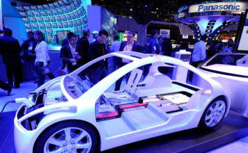 LAS VEGAS, NV - JANUARY 12: Attendees look at components for an electric vehicle at the Panasonic booth at the 2012 International Consumer Electronics Show at the Las Vegas Convention Center January 12, 2012 in Las Vegas, Nevada. CES, the world's largest annual consumer technology trade show, runs through January 13 and features more than 3,100 exhibitors showing off their latest products and services to about 140,000 attendees. Photo via AP.