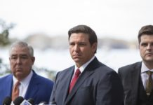 Governor Ron DeSantis, center, John Morgan, left, and U.S. Congressman Matt Gaetz, right, during a press conference to pressure state legislators and give them a mid-March deadline to repeal a law that prohibits smokable forms of medical marijuana at Kraft Azalea Garden in Winter Park, Fla., Thursday, Jan. 17, 2019. (Willie J. Allen Jr./Tampa Bay Times via AP)