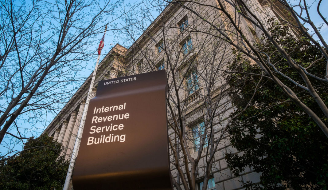 FILE- In this April 13, 2014 file photo, the Internal Revenue Service Headquarters (IRS) building is seen in Washington. (AP Photo/J. David Ake, File)