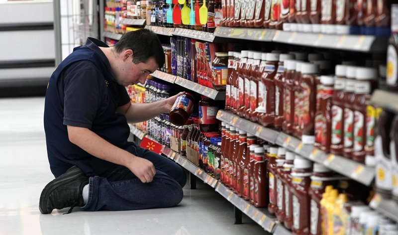 In this Nov. 9, 2018, file photo a Walmart associate stocks a shelf at a Walmart Supercenter in Houston. On Monday, Jan. 7, 2019, the Institute for Supply Management, a trade group of purchasing managers, issues its index of non-manufacturing activity for December. Photo via AP Photo/David J. Phillip.
