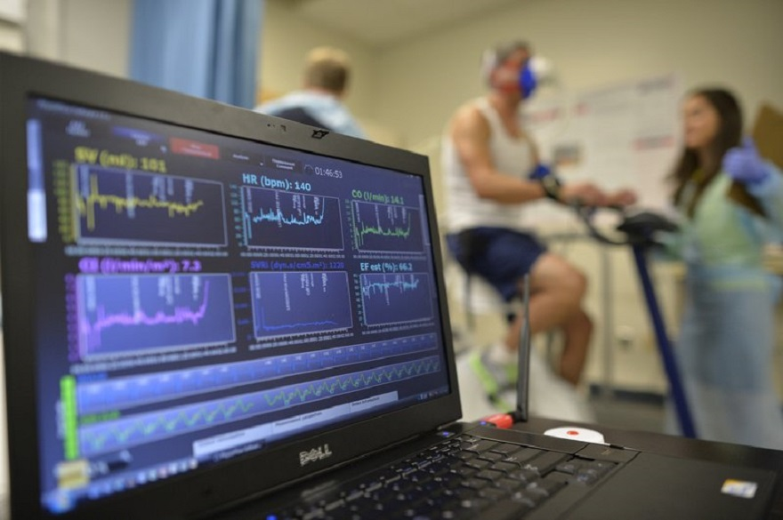 FILE - In this Aug. 27, 2014 file photo, a laptop computer monitors a patient's heart function as he takes a stress test while riding a stationary bike in Augusta, Ga. A report released on Wednesday, Jan. 30 2019 estimates that nearly half of all U.S. adults have some form of heart or blood vessel disease, a medical milestone that's mostly due to recent guidelines that expanded how many people have high blood pressure. (AP Photo/The Augusta Chronicle, Michael Holahan)