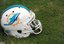 Houston, TX: Miami Dolphins helmet lies on the field before the start of their game against the Houston Texans on August 16, 2013 at Reliant Stadium in Houston, TX. Photo via CBS News.