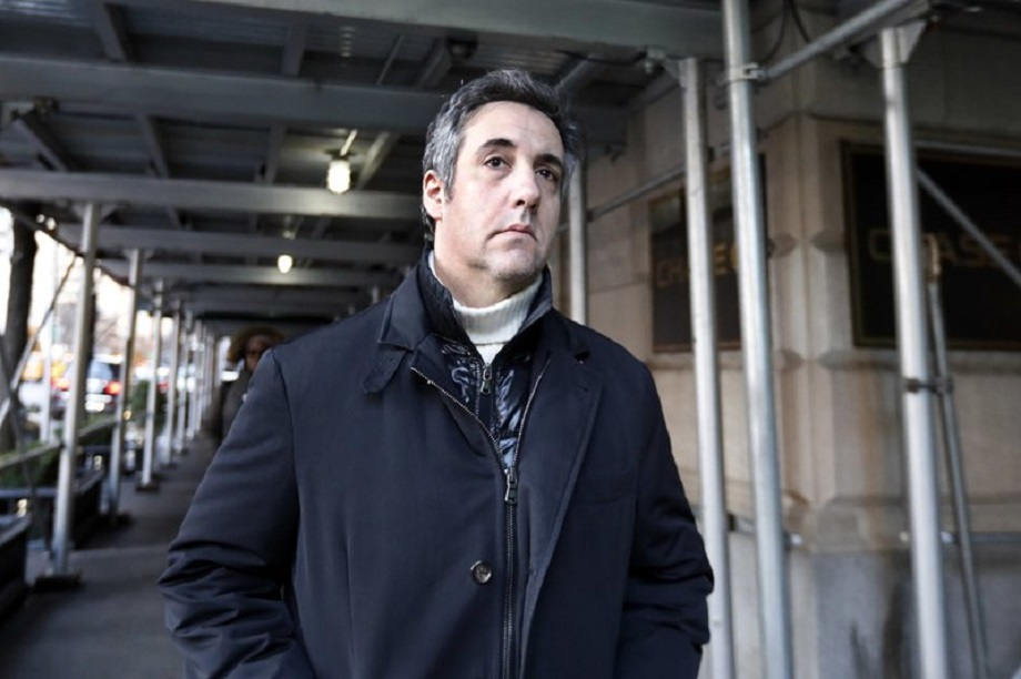 FILE - In this Dec. 7, 2018 file photo, Michael Cohen, former lawyer to President Donald Trump, leaves his apartment building in New York. A report by BuzzFeed News, citing two unnamed law enforcement officials, says that Trump directed Cohen to lie to Congress and that Cohen regularly briefed Trump on the project. The Associated Press has not independently confirmed the report. (AP Photo/Richard Drew, File)