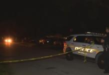 Police puts up crime scene tape as it investigates the death. Photo via WINK News.