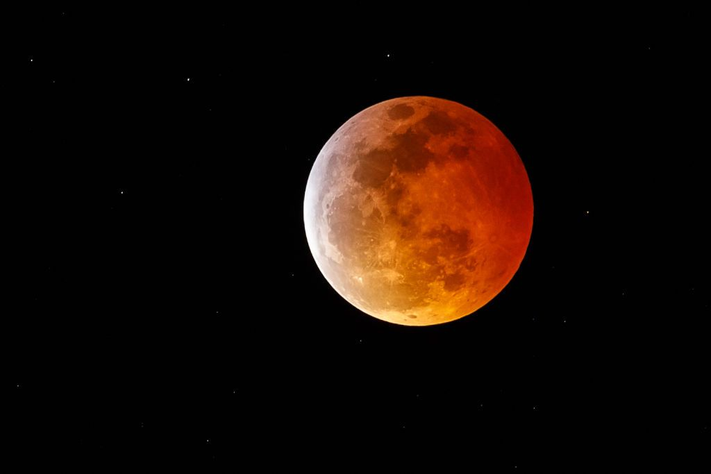 Super blood moon as seen Sunday evening. Photo via CBS News.