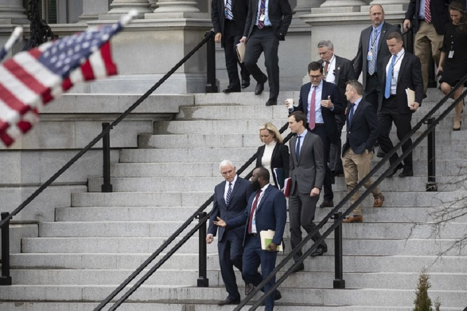 Vice President Mike Pence, left, White House legislative affairs aide Ja'Ron Smith, Homeland Security Secretary Kirstjen Nielsen, second row left, White House Senior Adviser Jared Kushner, and others, walk down the steps of the Eisenhower Executive Office building, on the White House complex, after a meeting with staff members of House and Senate leadership, Saturday, Jan. 5, 2019, in Washington. Photo via AP/Alex Brandon.