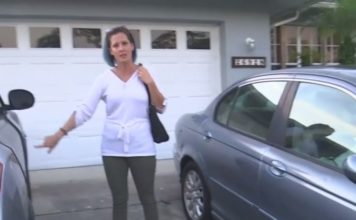 Victim points to an open door on her vehicle after an overnight burglary. Photo via WINK News.