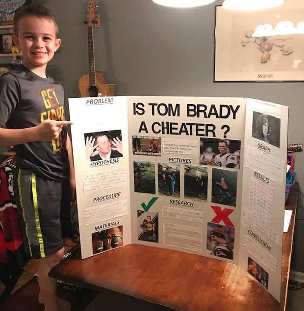 Ace Davis shows off his project for the school science fair. CBS News photo.