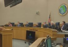 A Charlotte County resident addresses commissioners. (WINK News photo)