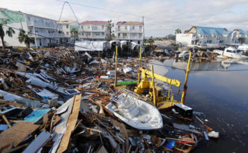 A boat sits amidst debris in the aftermath of Hurricane Michael in Mexico Beach, Fla., Thursday, Oct. 11, 2018. (AP photo)