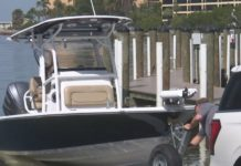 A vehicle pulls a boat. The method works as a temporary boat ramp. (WINK News photo)
