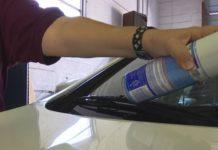 Car expert sprays air vents. (WINK News photo)