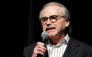 "FILE - In this Jan. 31, 2014 photo, David Pecker, Chairman and CEO of American Media, addresses those attending the Shape & Men's Fitness Super Bowl Party in New York. An attorney for the head of the National Enquirer's parent company says the tabloid didn't commit extortion or blackmail by threatening to publish Amazon CEO Jeff Bezos' explicit photos. Elkan Abramowitz represents American Media Inc. CEO David Pecker. He defended the tabloid's practice as a ""negotiation"" in an interview Sunday, Feb. 10, 2019, with ABC News. (Marion Curtis via AP, File)"